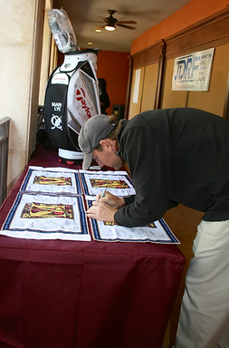 Professional Golfers sign commemorative flags