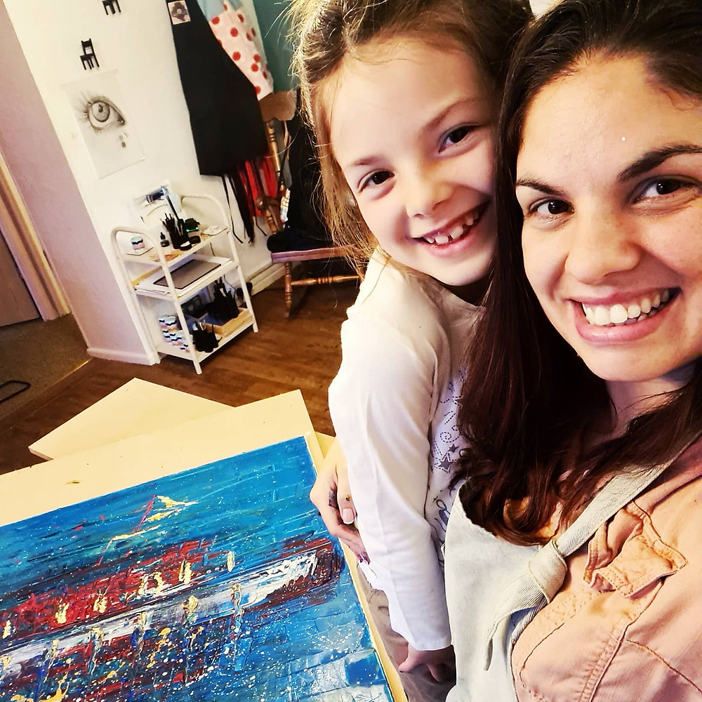 A picture of Emma and her daughter painting in the Joyous Misfit workshop.