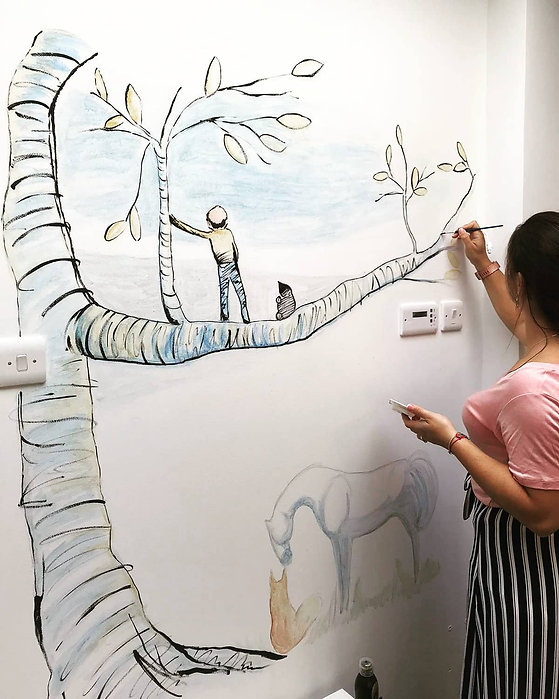 artist painting wall mural