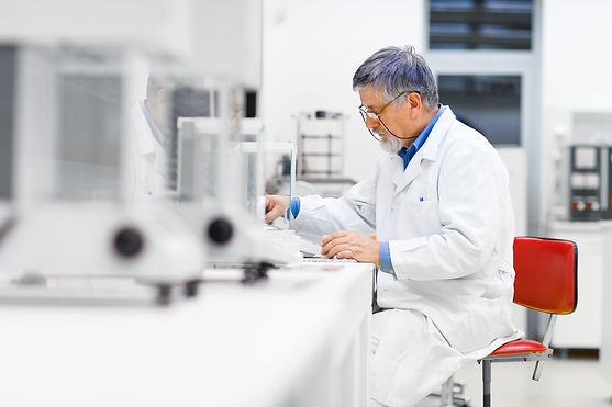 Man in labcoat developing moulds