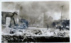 Individuals viewing destruction