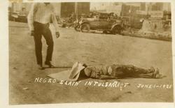 Man looking at deceased man