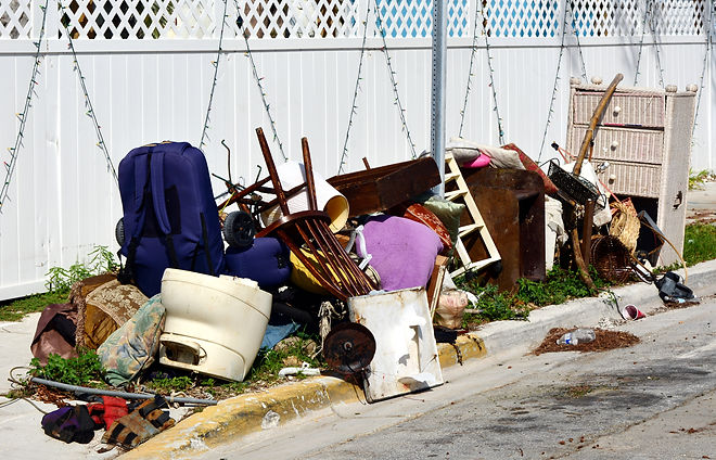 A pile of household furnishings, damaged