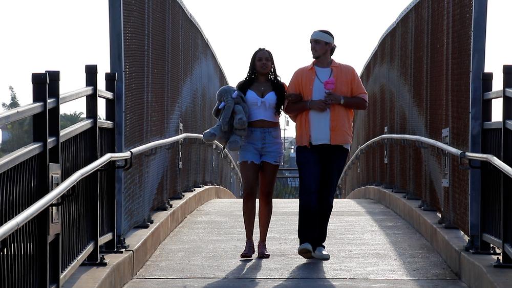 """Kasland & Alexis Stephens on the """"Paradise"""" music video set."""