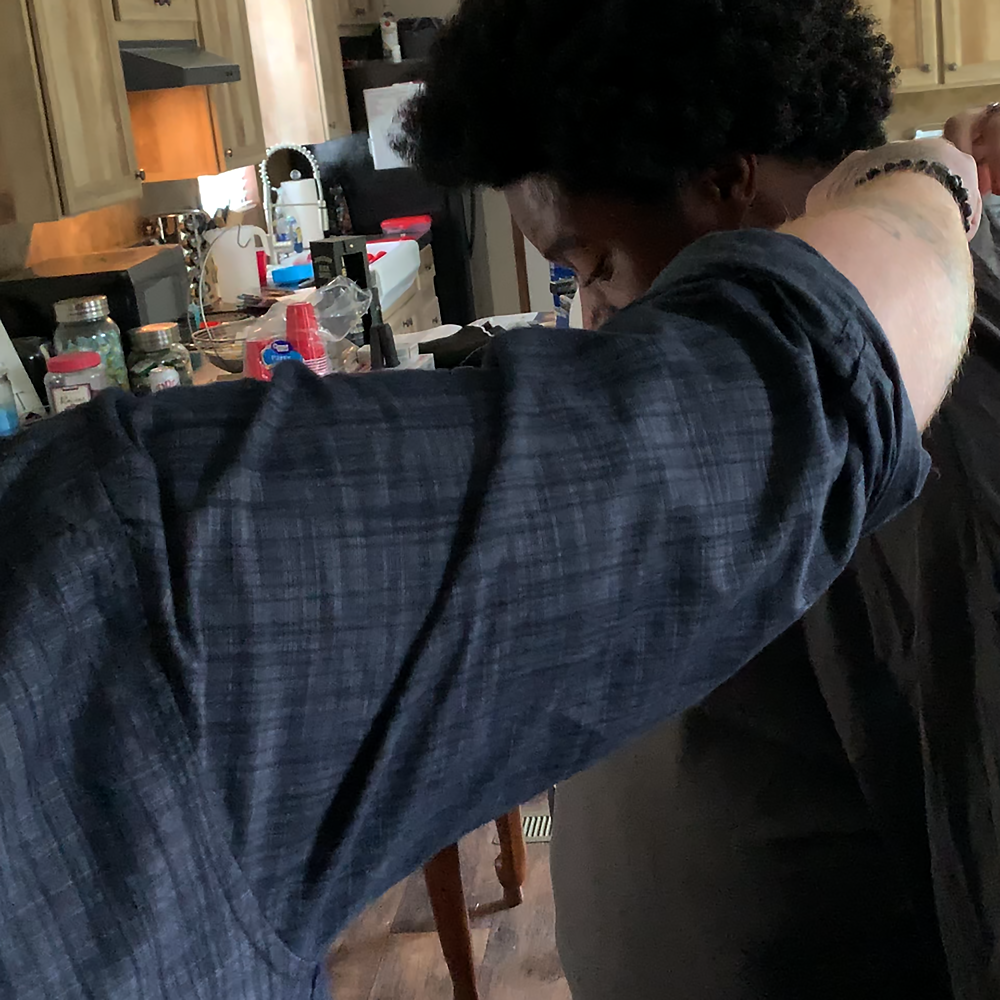 """Ja'Darrius Mitchell being suited up for Kasland's """"Walk With Me"""" music video."""