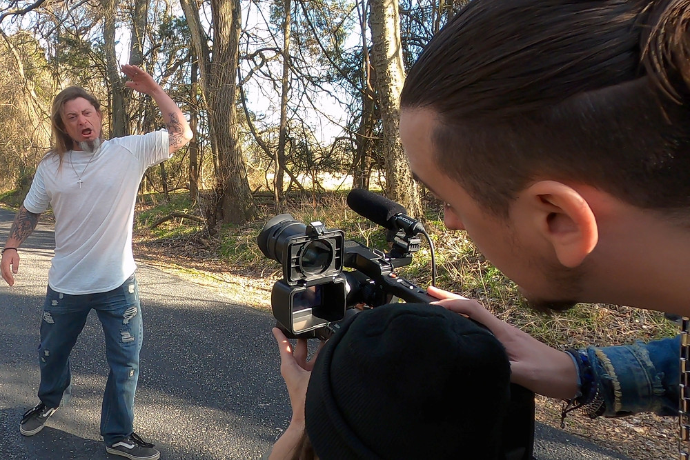 """Kasland and T Man filming Justin Dowden on the """"Walk With Me"""" music video set."""
