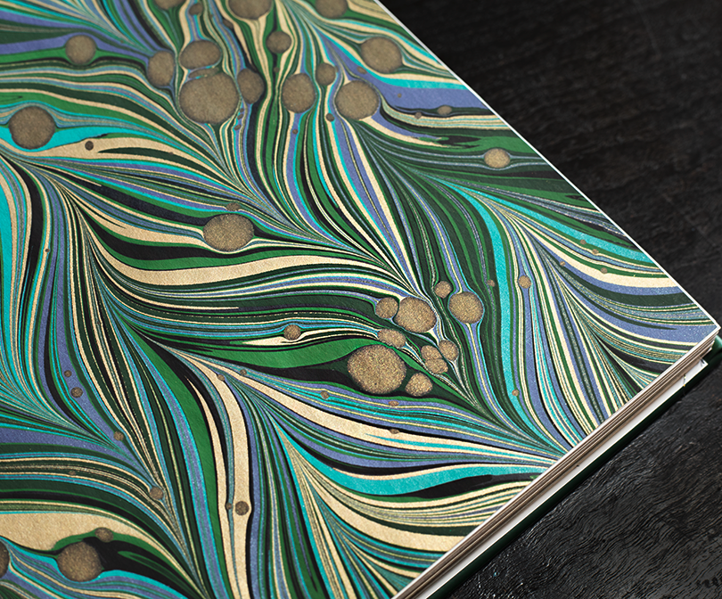 The deluxe clamshell edition finished with hand-dipped endpapers by artist Renaldo Crepaldi.