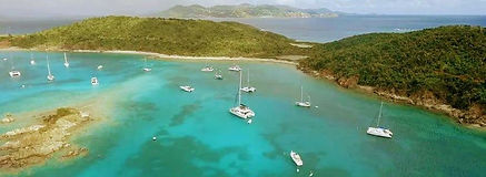 St Thomas Boat Charter - Phoenix Island Charters at work anchored in secluded bay