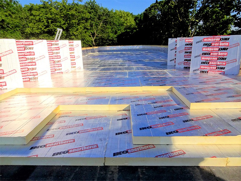 Insulation being laid on a flat roof