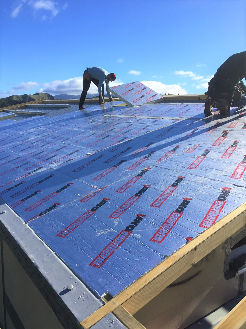 Pitched roof with insulation being laid