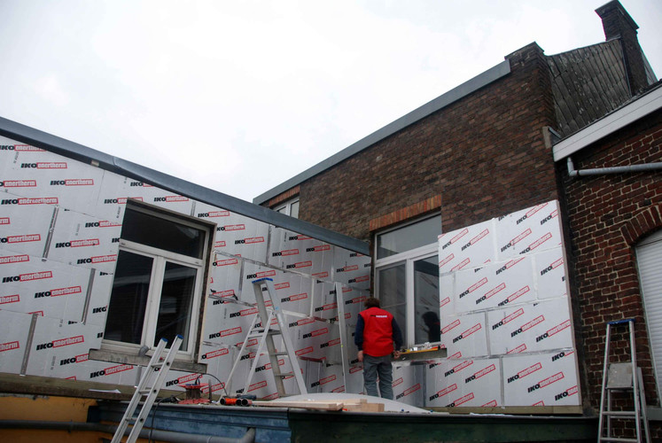 Two exterior walls being insulated