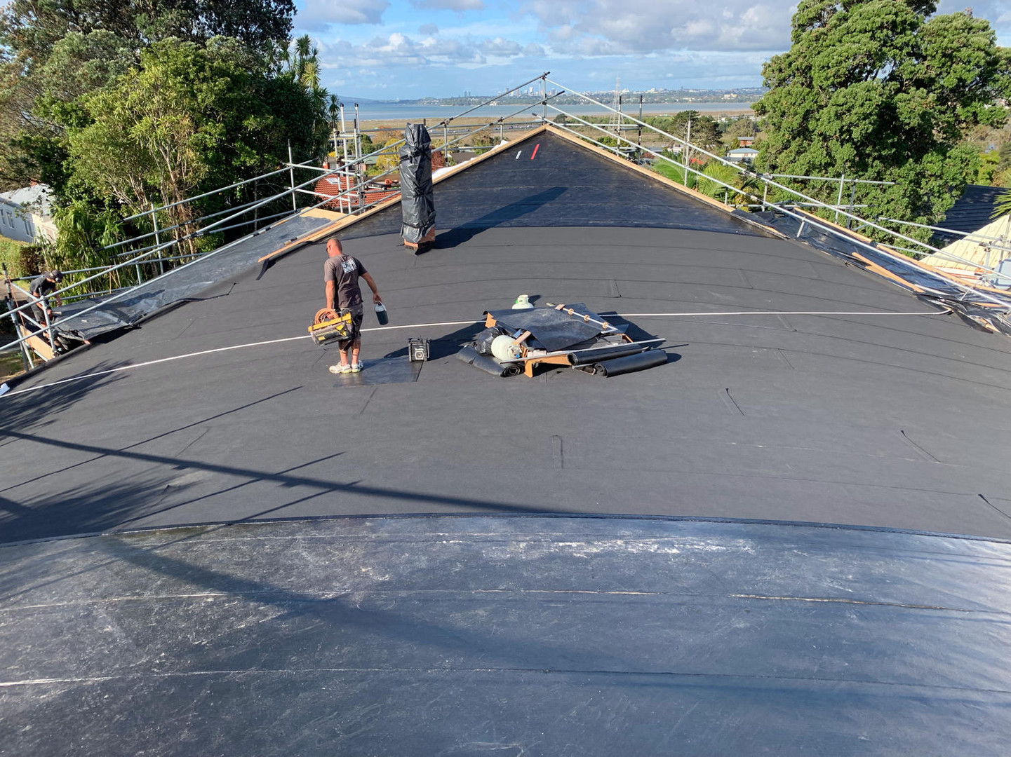 Overlaying an existing metal tray roof.