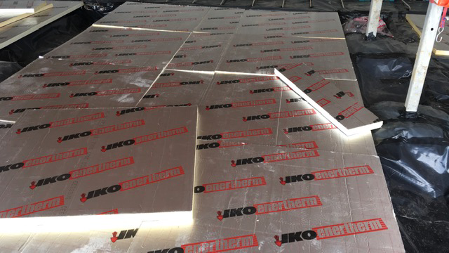 Showing floor insulation being installed