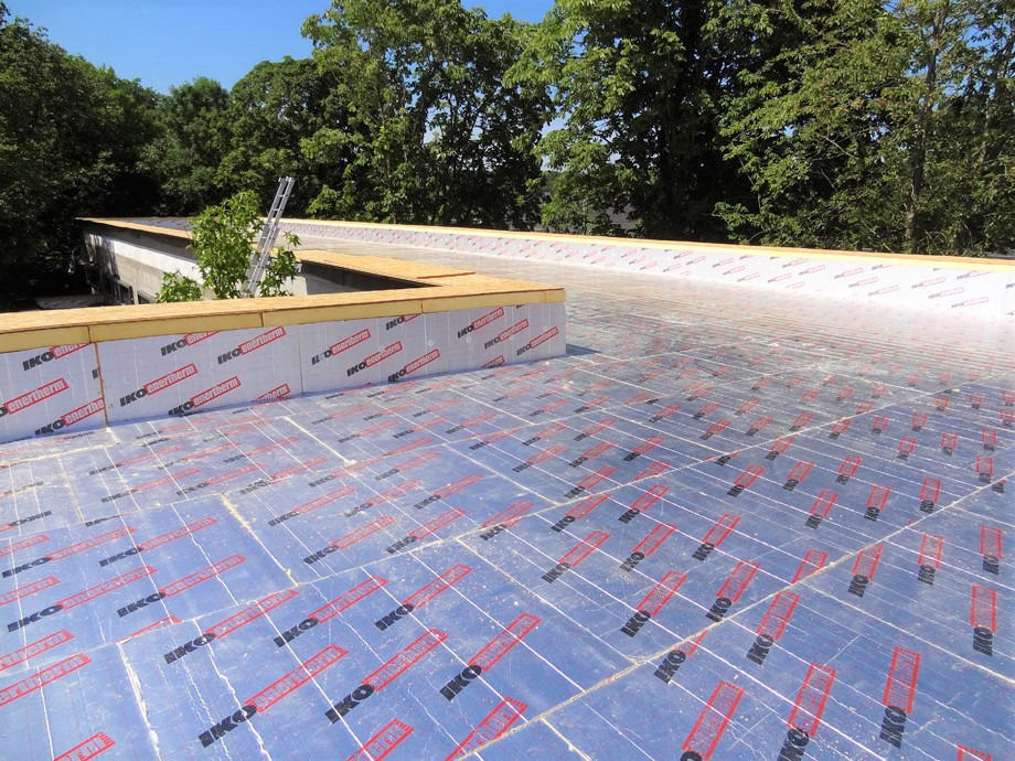 Roof insulation before membrane installed over top