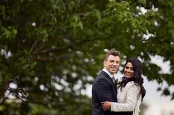 newlyweds smiling at camera