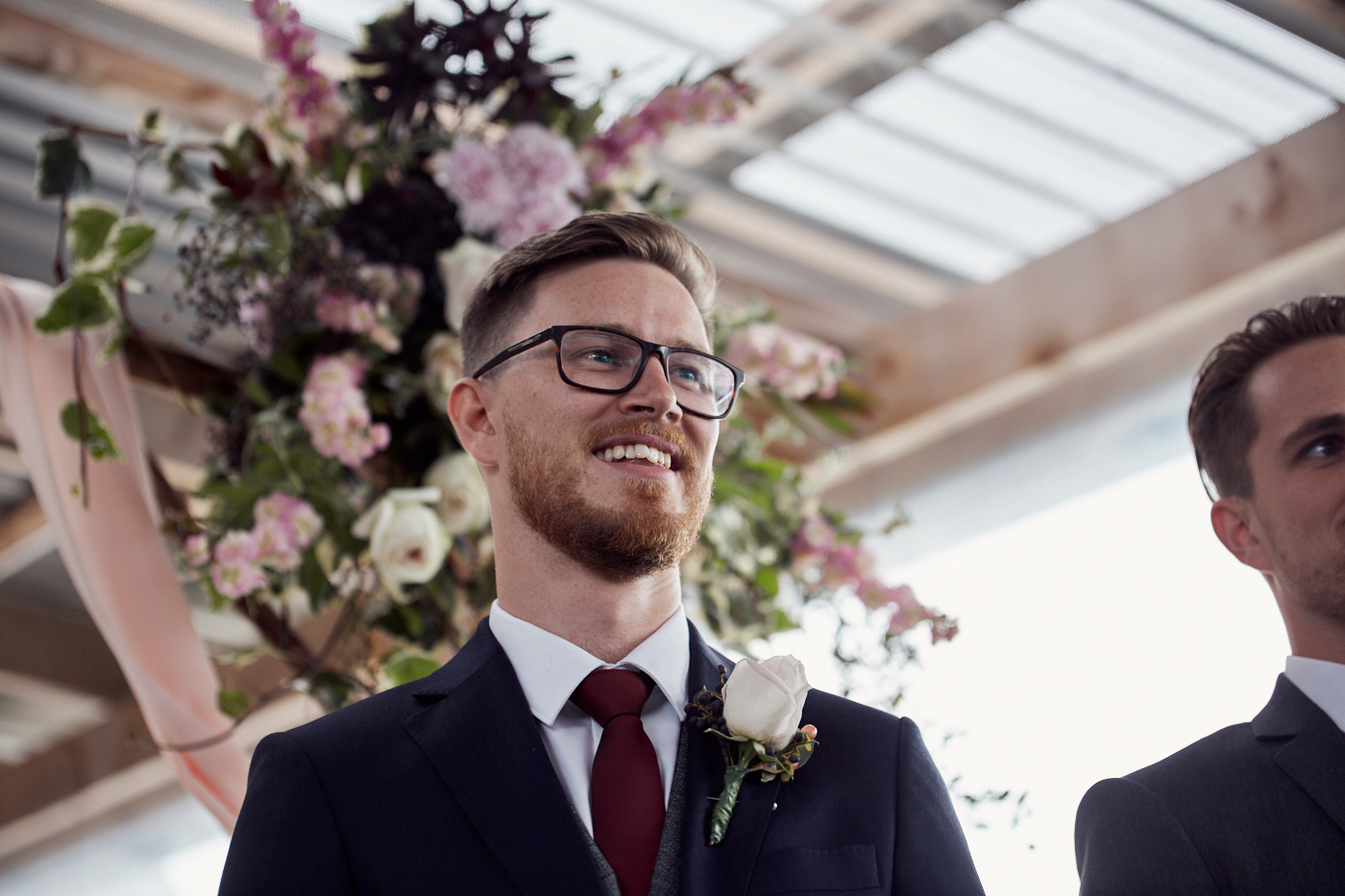 Groom smiling at his bride