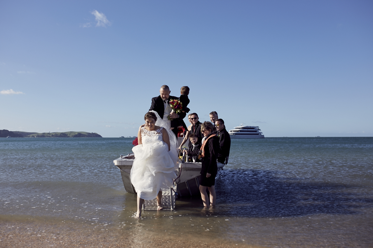 wedding party getting off boat
