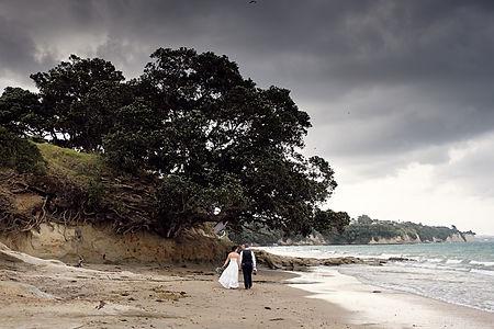 Newlyweds walking along a beach