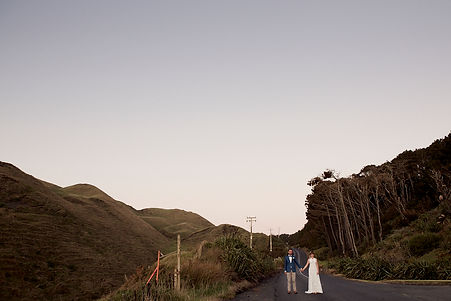 Couple standing on a country road