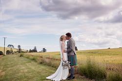 A kiss by a field