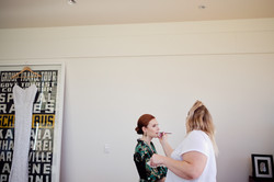bridesmaid getting make up applied