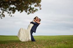 groom lifts bride