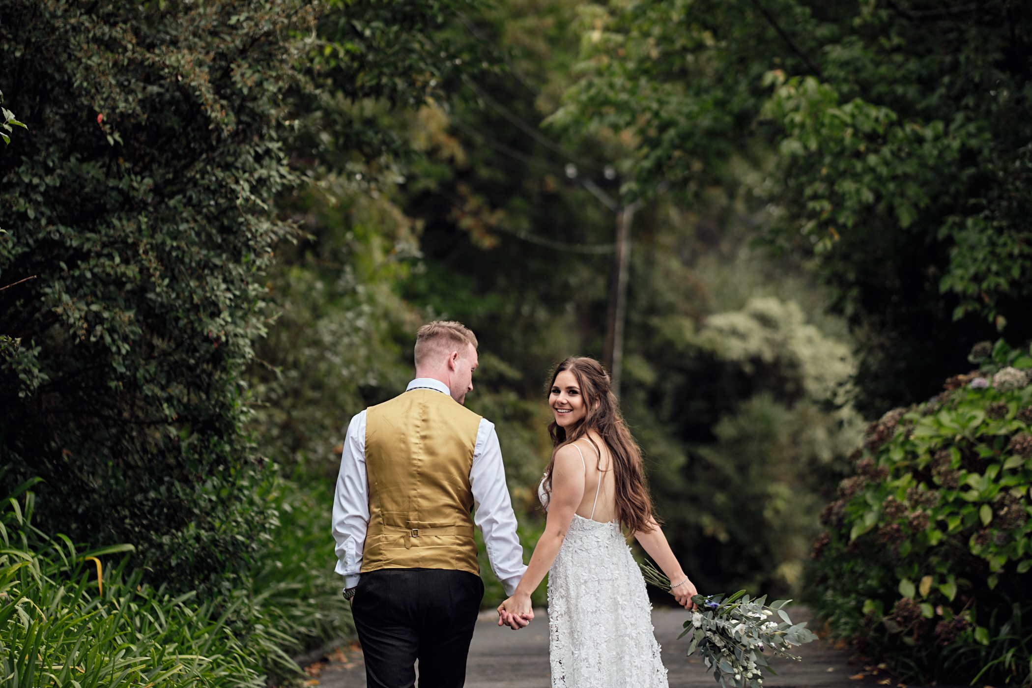 Bride looks back at photographer