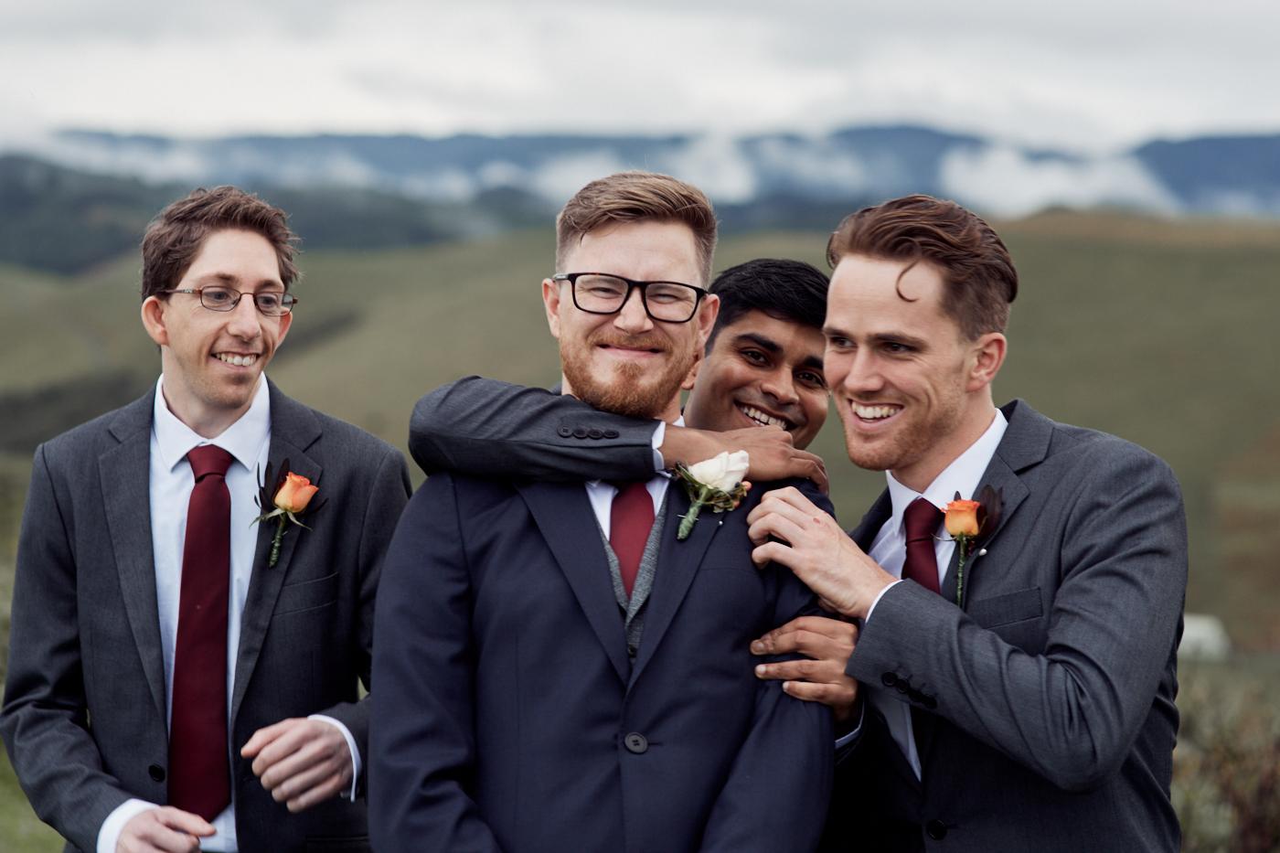 Groom and groomsmen fooling around