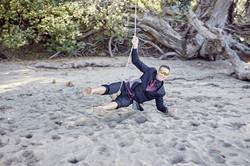 groomsman having fun on swing