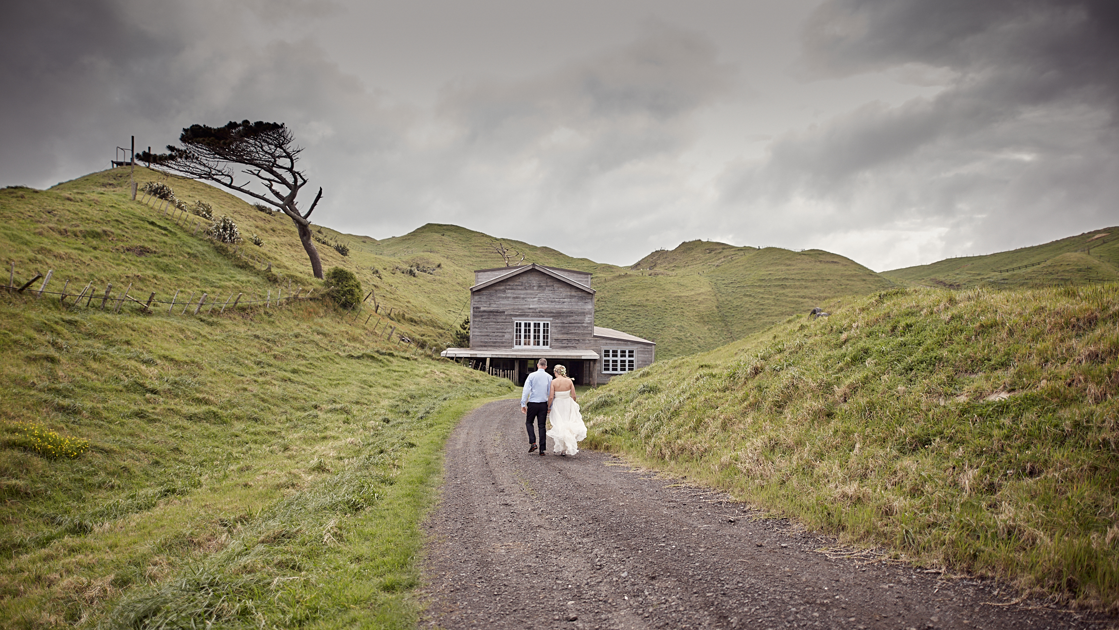 couple walking towards barn