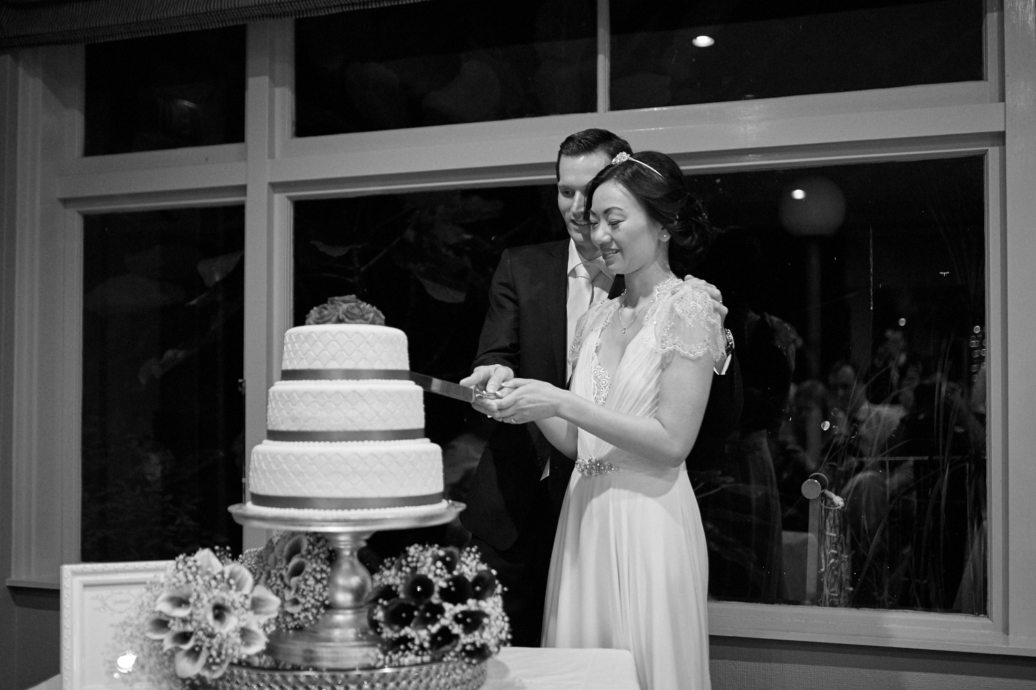 cutting cake at wedding