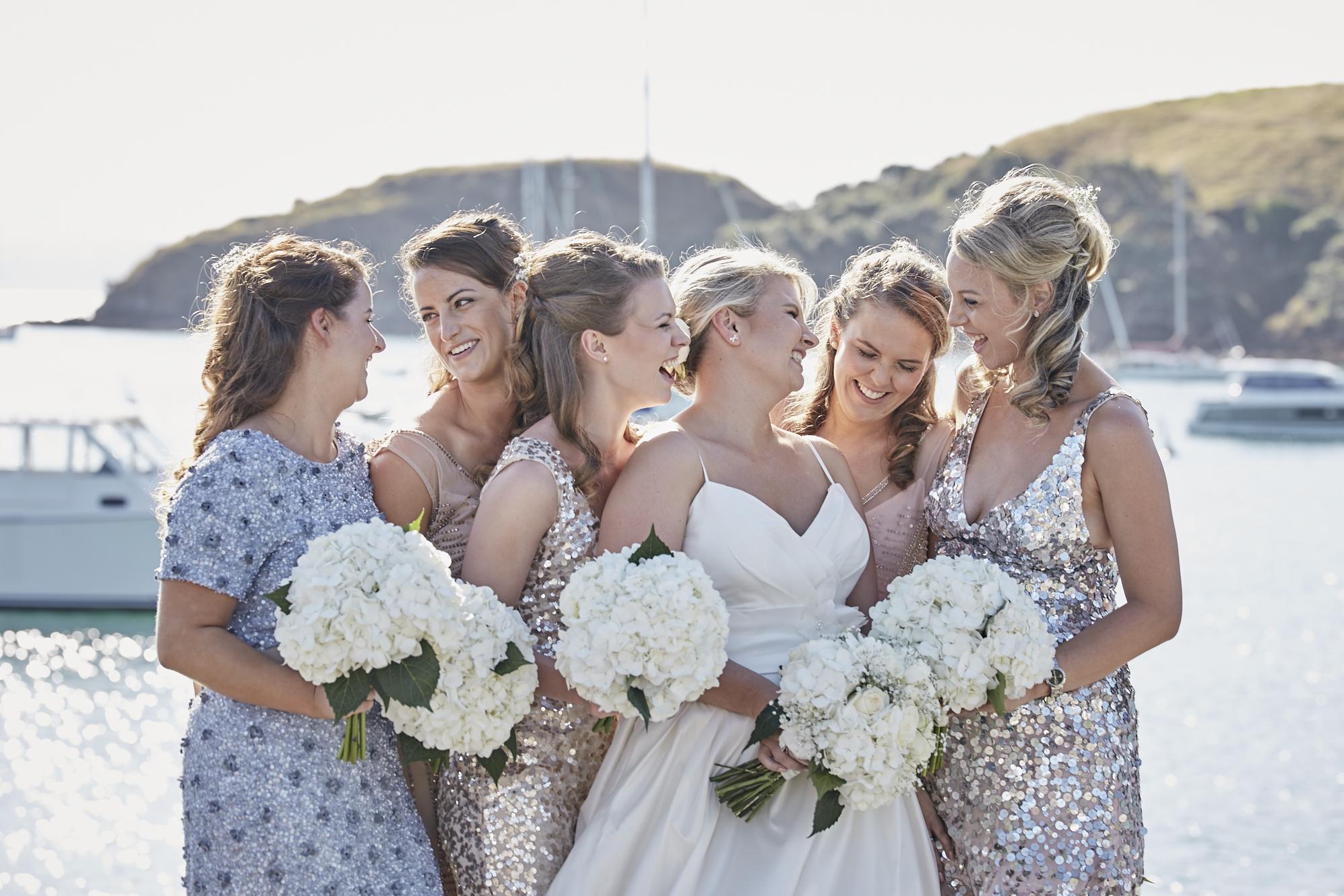 Bridesmaids around the bride