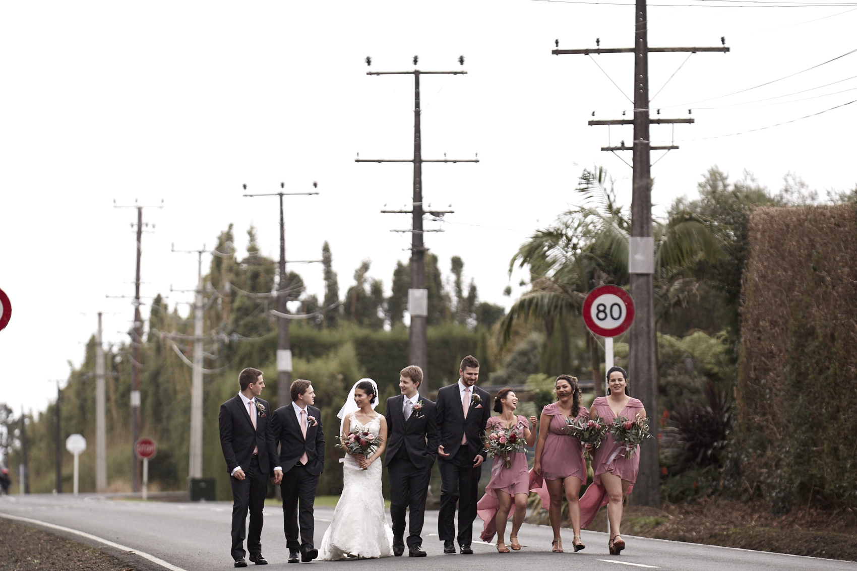 Bridal party walking down road