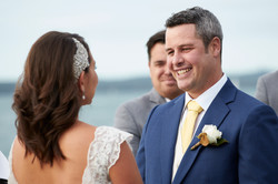 The groom smiling