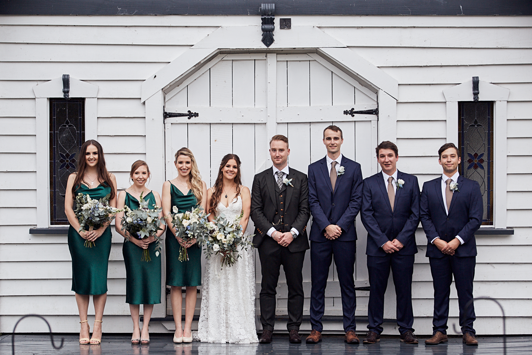 The wedding party posing for photo