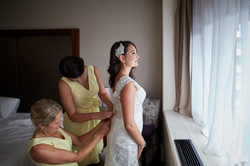 Doing up the bride's dress
