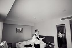 groom in hotel room