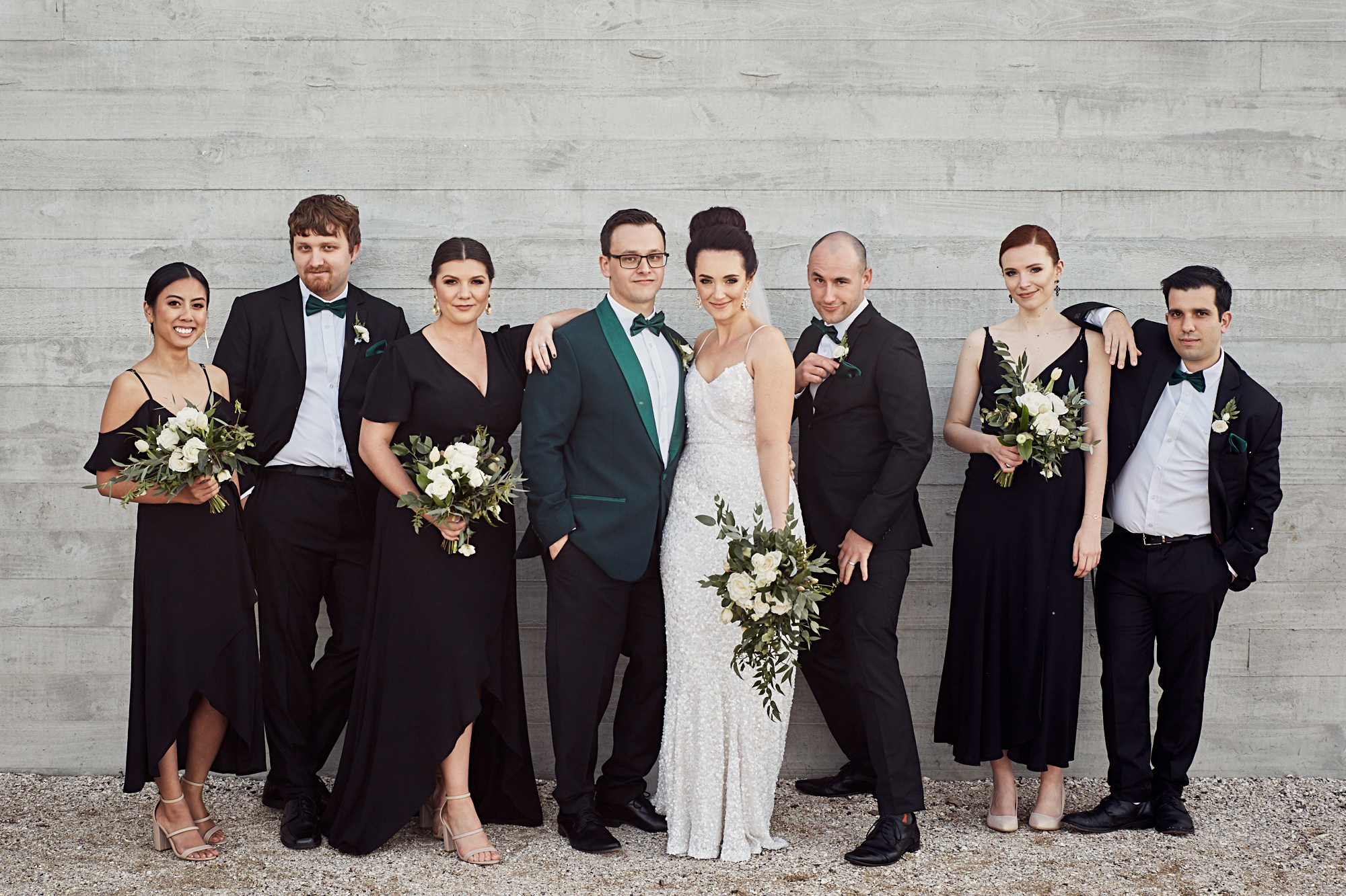 Bridal party posing for photographer
