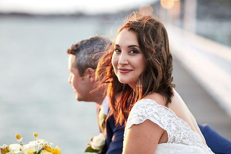 The bride and groom on a pier