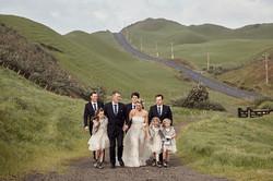 bridal party walking up road