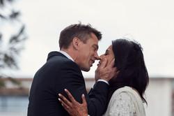 groom and bride kiss