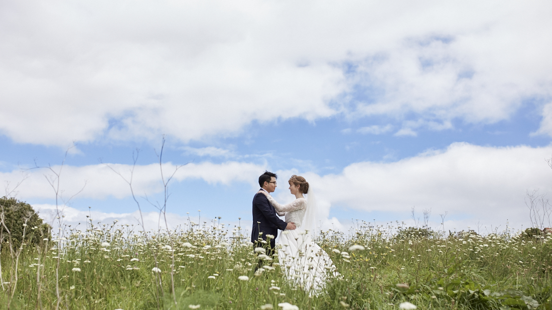 newlyweds in field