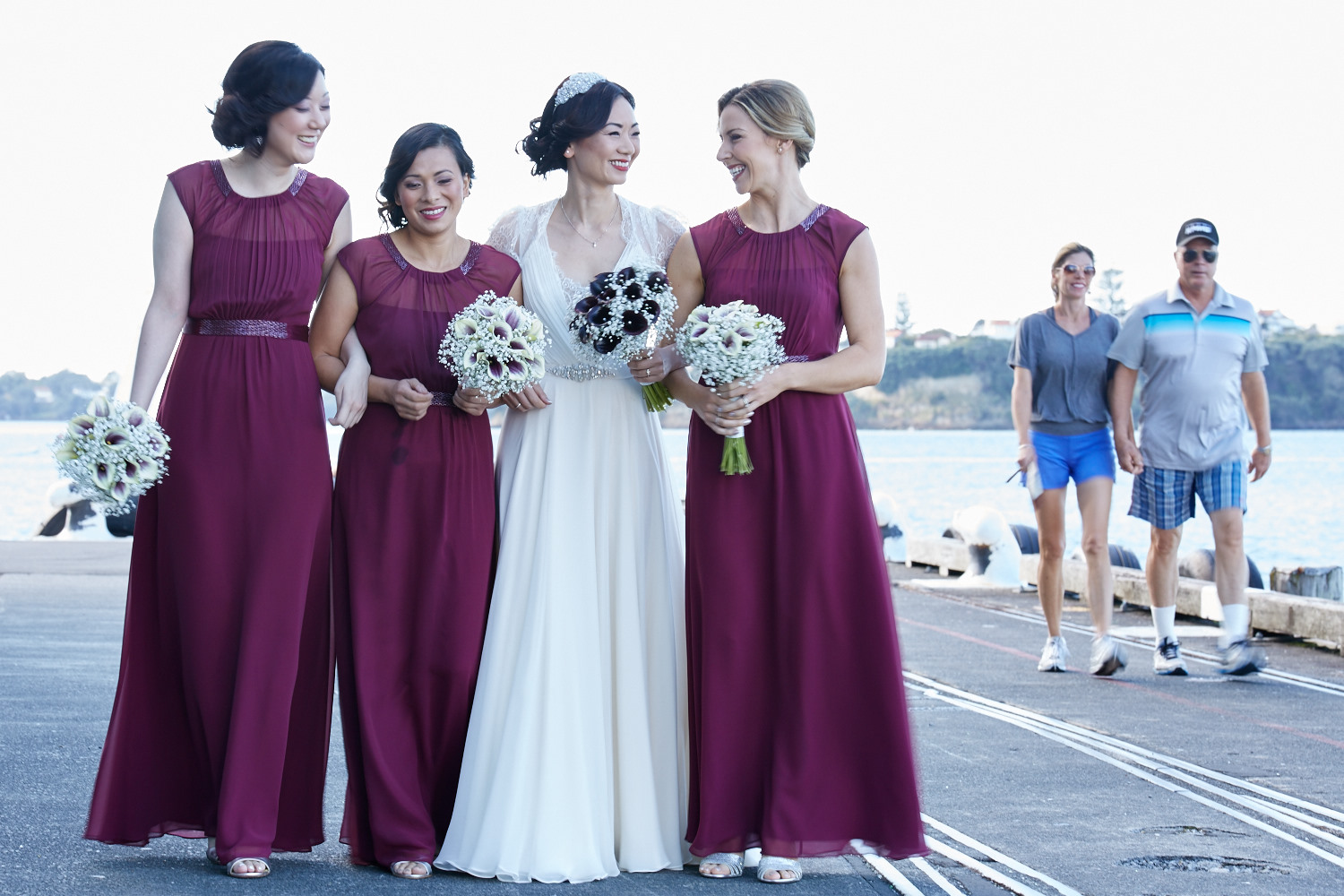 The bride walking with bridesmaids
