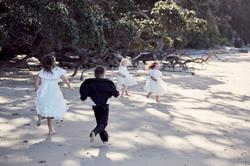 kids running along beach