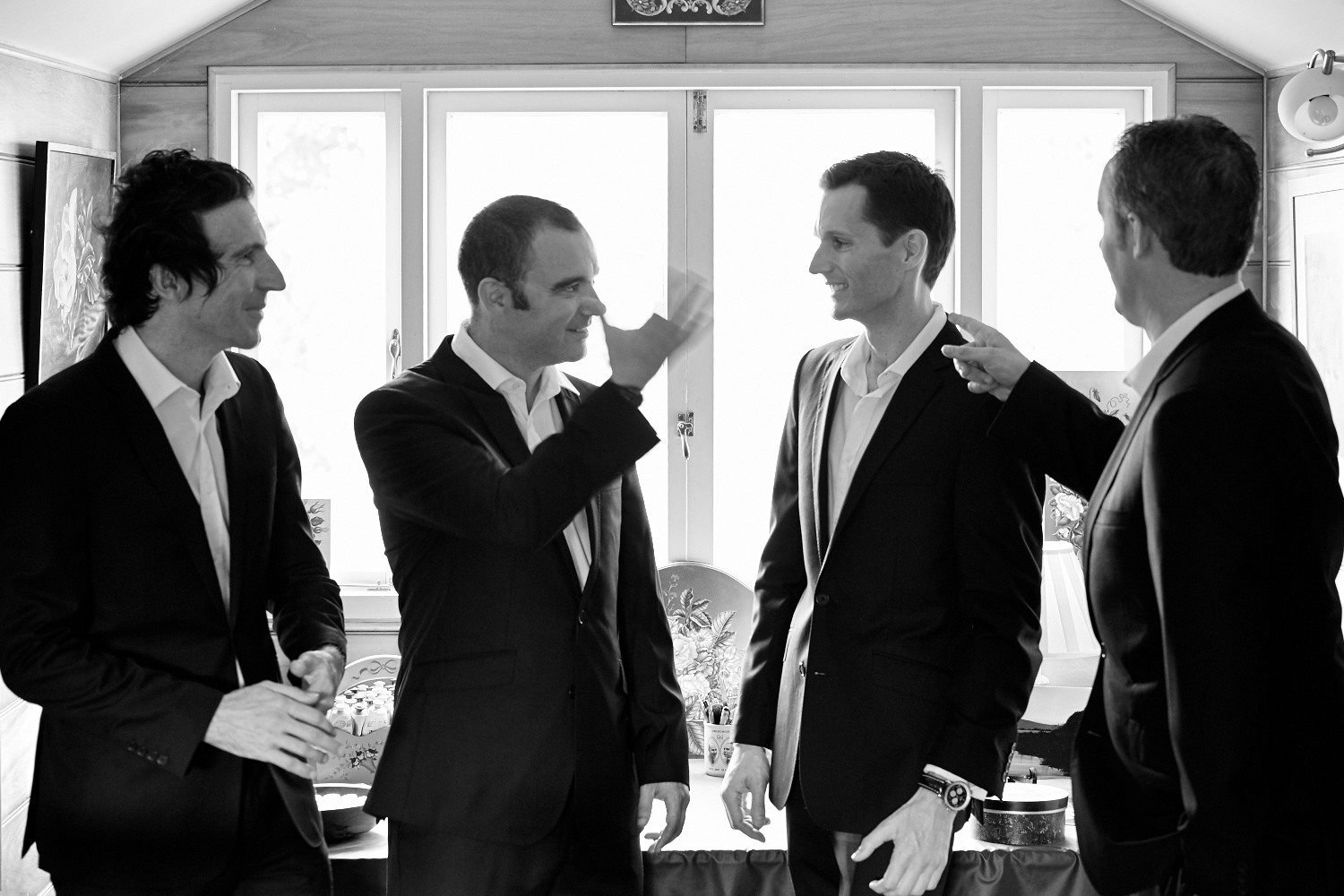 wedding groomsmen talking