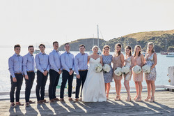 The wedding party standing together