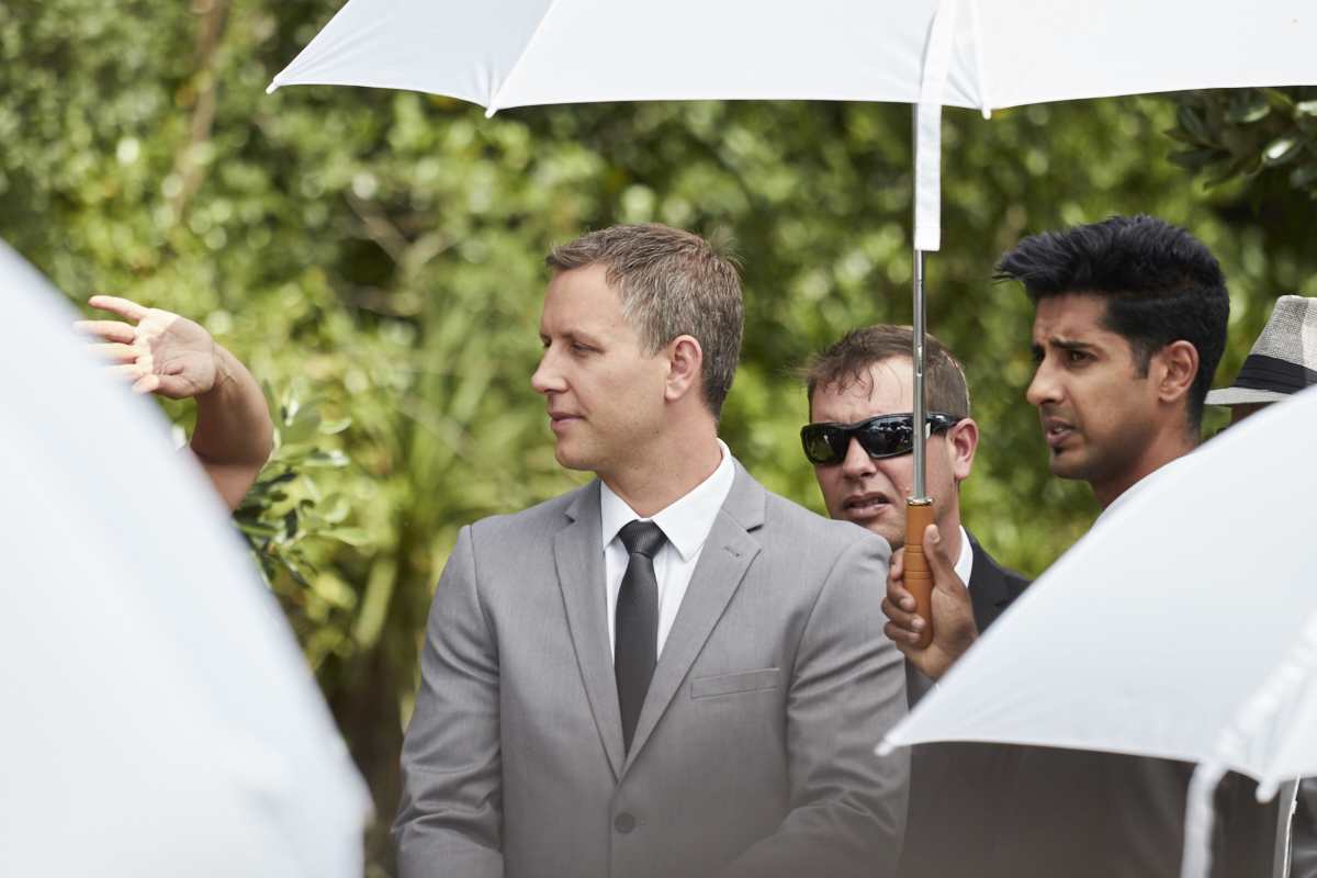 groom under umbrella