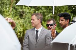 groom under umbrella