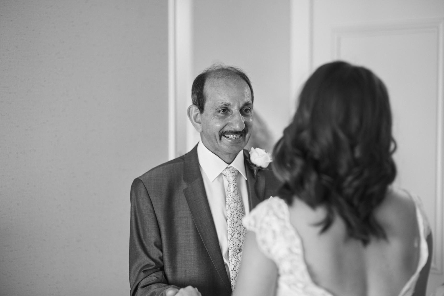 Emotional dad with bride