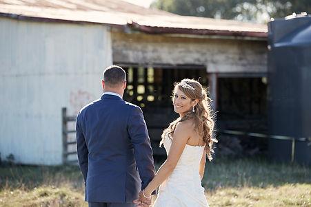 Bride looking over her shoulder at wedding photographer